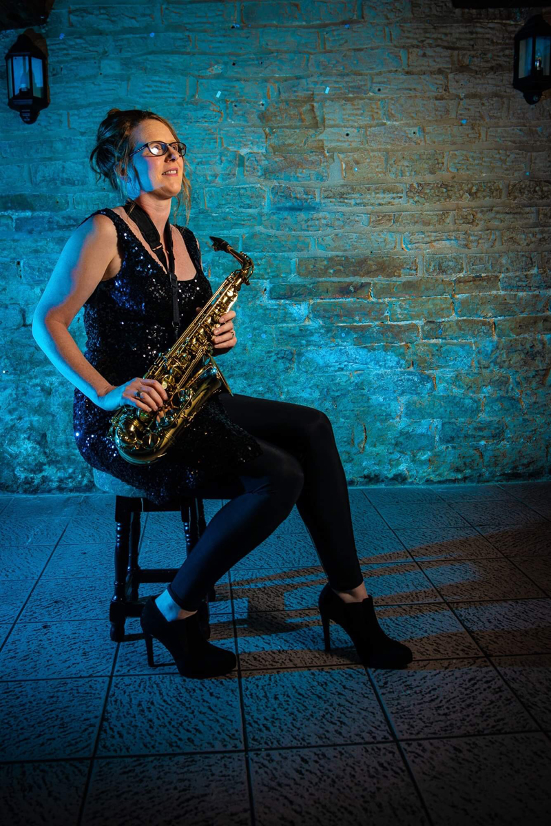 Katie Proskins Slim Playing Saxophone